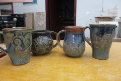 One of a Kind Carved Mugs